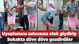 Uyuşturucu satıcısına etek giydirip sokakta döve döve gezdirdiler