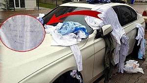 Eve gelmeyen eşinin kıyafetlerini otomobile bağlayıp bakın ne yazdı