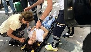Binanın saçağından düşen taş parçası genç kadını hastanelik etti