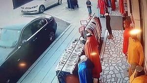 Giyim mağazasına torpil atan çocuk elbiseleri yaktı