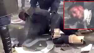 Fransız polisi göstericiyi döverek bayılttı