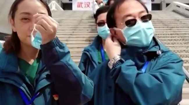 Çin'de maskeler çıkartılmaya başlandı