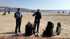 Korona virüsten korunmak için evde kalmak yerine sahile koştular