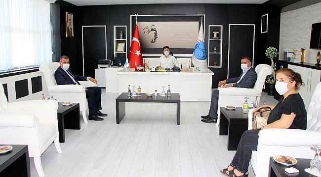 MHP İl Başkanı Demir, Rektör Karacoşkun'la bir araya geldi