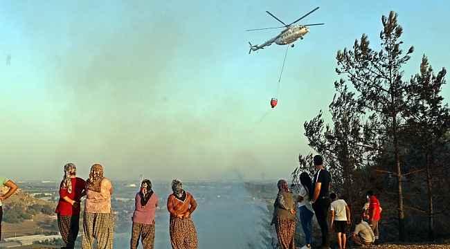 Evlerine yakın bölgede çıkan orman yangınından panikle kaçtılar