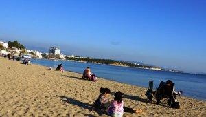 Güneşi gören, sahile indi