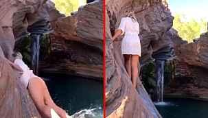 Poz uğruna kayalıklara tırmanan model dengesine kaybedince suya düştü