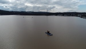 Ayvacık'ta suya kapılanların arama çalışmaları havadan görüntülendi