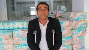 İhtiyaç sahiplerine tekerlekli sandalye ve bez desteği