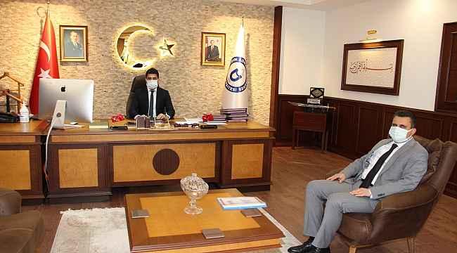 TÜİK Denizli Bölge Müdürü Coşkun, Rektör Aldemir'le görüştü