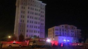 Burdur'da 10 katlı binanın çatısında intihar girişimi