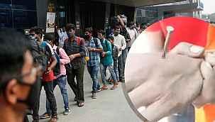 Hindistan'da polisten maske takmama cezası... Eline çivi çaktılar
