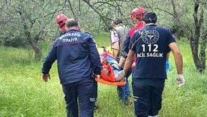 Tarlada ayağı kayan yaşlı kadın 20 metre yükseklikten dereye düştü